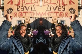 adwoa addae står med en BLM-skylt